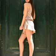 h-era nude playsuit with ruffles side