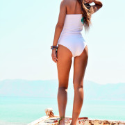 h-era white one-piece swimsuit back